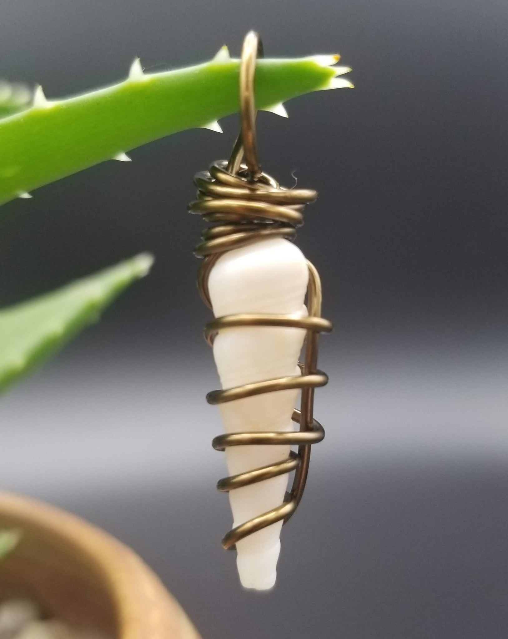 Pendant (turritella shell-white/bronze wire)
