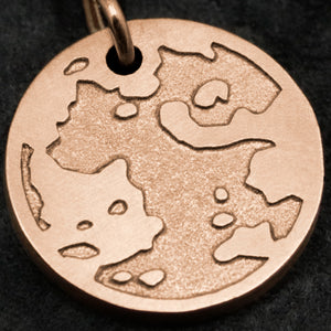 Detail view of 18K Rose Gold Journey pendant featuring the Map of Humanity as outward journey by Caps Brothers