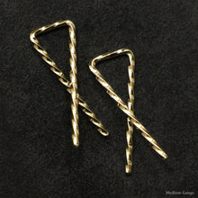 Load image into Gallery viewer, Detail view of 18K Yellow Gold Sibling Ribbons Twisted Earrings representing we are all brothers and sisters by Caps Brothers