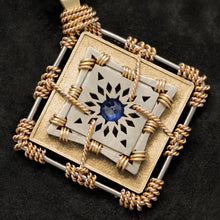 Load image into Gallery viewer, Detail view of 18K Yellow Gold and 18K Palladium White Gold and Sapphire Sewn Gold Metal Confidence pendant featuring 4 pointed gear by Caps Brothers