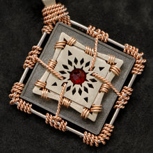 Load image into Gallery viewer, Detail view of 18K Rose Gold and 18K Palladium White Gold and Sterling Silver and Ruby Sewn Gold Metal Confidence pendant featuring 4 pointed gear by Caps Brothers