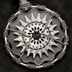 Detail view of Sterling Silver and 18K Palladium White Gold Accents and Black Sapphire Sewn Silver Metal Majesty pendant featuring 20 pointed gear by Caps Brothers