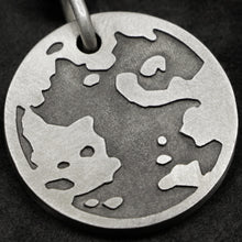 Load image into Gallery viewer, Detail view of Sterling Silver Journey pendant featuring the Map of Humanity as outward journey by Caps Brothers