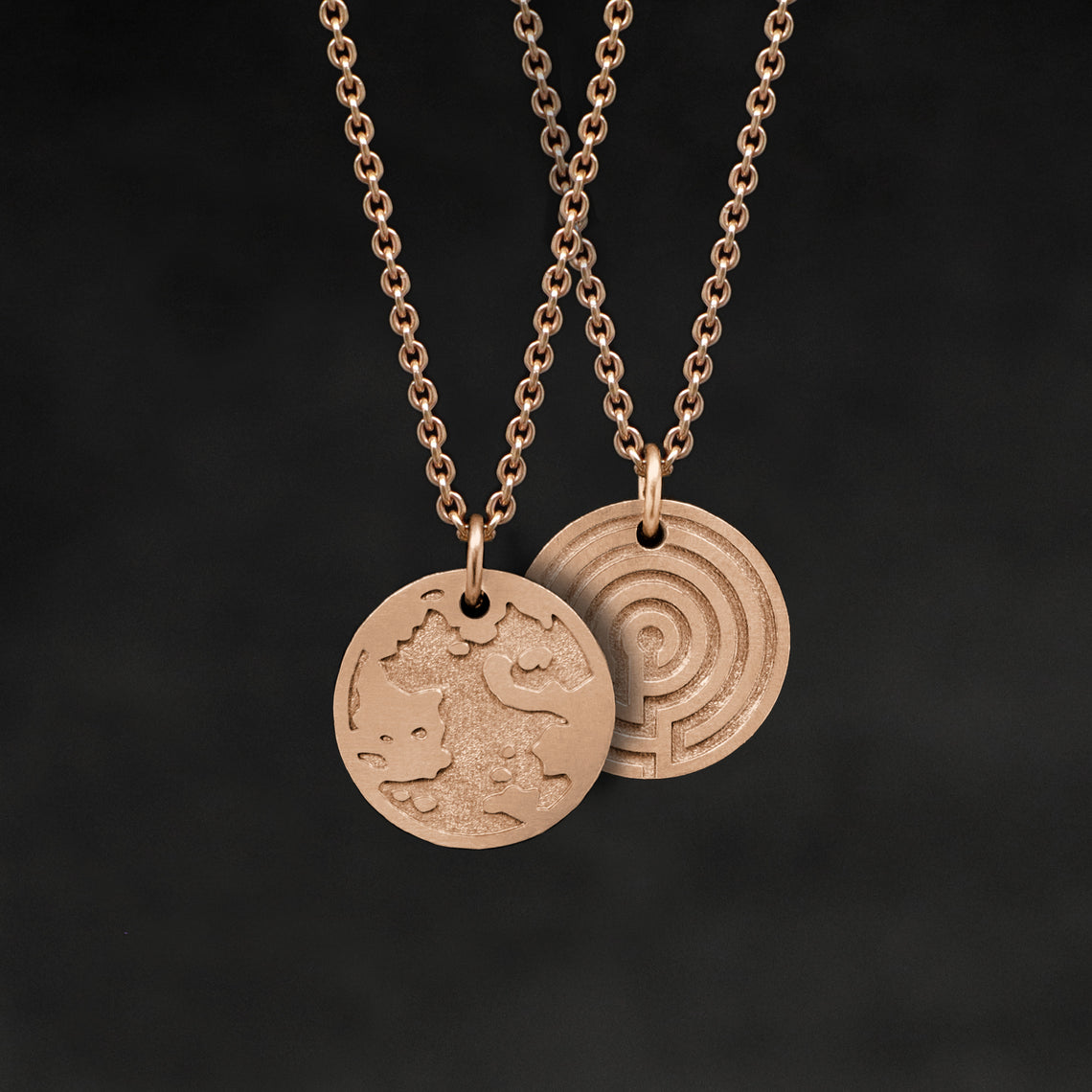 Hanging view of 18K Rose Gold Journey pendant and chain necklace featuring the Map of Humanity as outward journey and labyrinth as inward journey by Caps Brothers