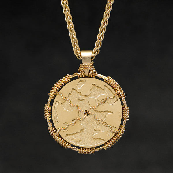 Hanging reverse view of 18K Yellow Gold Sewn Gold Metal Sun pendant and chain with endless loop necklace featuring Map of Humanity by Caps Brothers