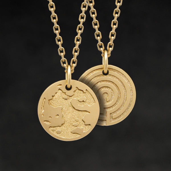 Hanging view of 18K Yellow Gold Journey pendant and chain with endless loop necklace featuring the Map of Humanity as outward journey and labyrinth as inward journey by Caps Brothers