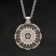 Load image into Gallery viewer, Hanging front view of 18K Palladium White Gold and Sterling Silver Sewn Gold Metal Compass pendant and chain with endless loop necklace featuring 20 pointed gear by Caps Brothers