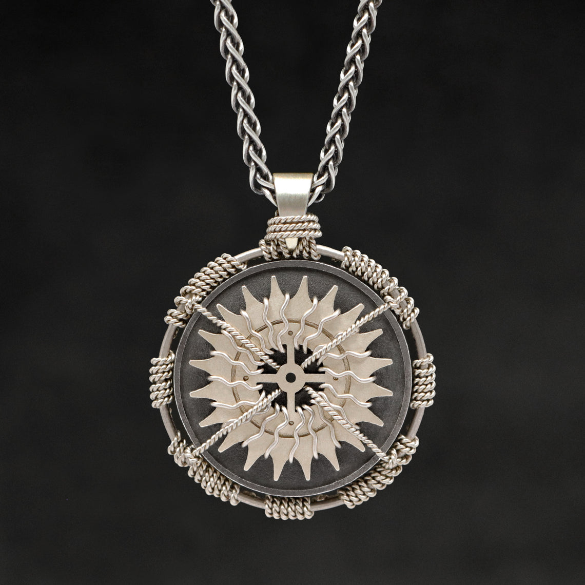 Hanging front view of 18K Palladium White Gold and Sterling Silver Sewn Gold Metal Compass pendant and chain with endless loop necklace featuring 20 pointed gear by Caps Brothers