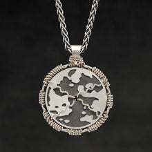 Load image into Gallery viewer, Hanging reverse view of 18K Palladium White Gold and Sterling Silver Sewn Gold Metal Compass pendant and chain with endless loop necklace featuring Map of Humanity by Caps Brothers