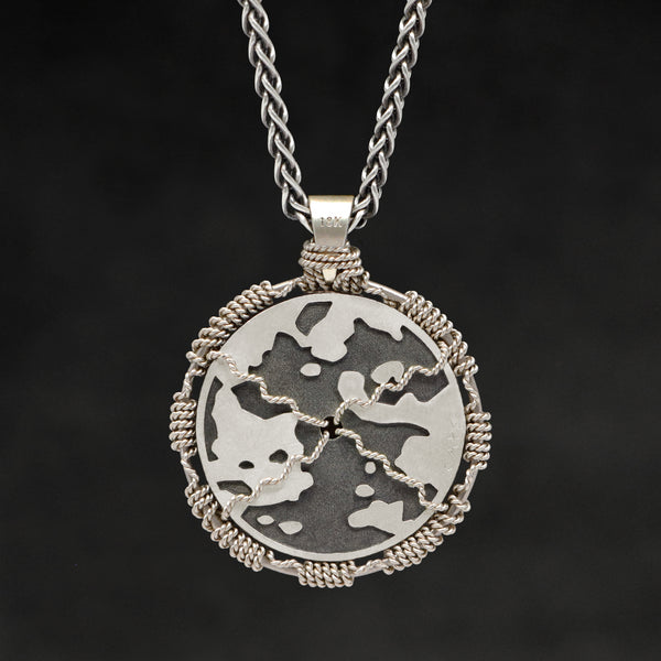 Hanging reverse view of 18K Palladium White Gold and Sterling Silver Sewn Gold Metal Compass pendant and chain with endless loop necklace featuring Map of Humanity by Caps Brothers