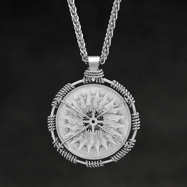 Hanging front view of Platinum 950 Sewn Platinum Metal Compass pendant and chain with endless loop necklace featuring 20 pointed gear by Caps Brothers