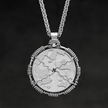 Load image into Gallery viewer, Hanging reverse view of Platinum 950 Sewn Platinum Metal Compass pendant and chain with endless loop necklace featuring Map of Humanity by Caps Brothers