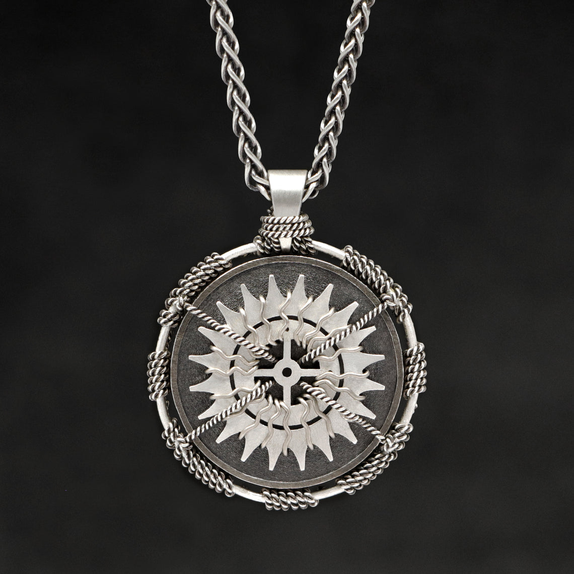 Hanging front view of Sterling Silver and 18K Palladium White Gold Accents Sewn Silver Metal Compass pendant and chain with endless loop necklace featuring 20 pointed gear by Caps Brothers