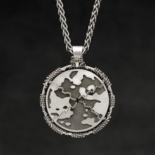 Load image into Gallery viewer, Hanging reverse view of Sterling Silver and 18K Palladium White Gold Accents Sewn Silver Metal Compass pendant and chain with endless loop necklace featuring Map of Humanity by Caps Brothers