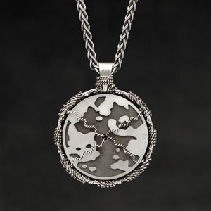 Hanging reverse view of Sterling Silver and 18K Palladium White Gold Accents Sewn Silver Metal Compass pendant and chain with endless loop necklace featuring Map of Humanity by Caps Brothers