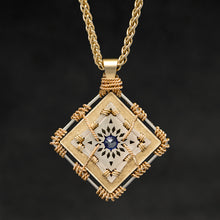 Load image into Gallery viewer, Hanging front view of 18K Yellow Gold and 18K Palladium White Gold and Sapphire Sewn Gold Metal Confidence pendant and chain with endless loop necklace featuring 4 pointed gear by Caps Brothers