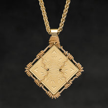 Load image into Gallery viewer, Hanging reverse view of 18K Yellow Gold and 18K Palladium White Gold Sewn Gold Metal Confidence pendant and chain with endless loop necklace featuring Electromagnetic Field and Cardinal Directions by Caps Brothers