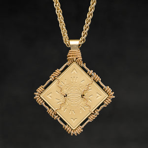 Hanging reverse view of 18K Yellow Gold and 18K Palladium White Gold Sewn Gold Metal Confidence pendant and chain with endless loop necklace featuring Electromagnetic Field and Cardinal Directions by Caps Brothers
