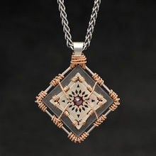 Load image into Gallery viewer, Hanging front view of 18K Rose Gold and 18K Palladium White Gold and Sterling Silver and Ruby Sewn Gold Metal Confidence pendant and chain with endless loop necklace featuring 4 pointed gear by Caps Brothers