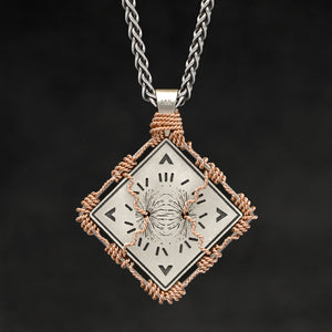 Hanging reverse view of 18K Rose Gold and 18K Palladium White Gold and Sterling Silver Sewn Gold Metal Confidence pendant and chain with endless loop necklace featuring Electromagnetic Field and Cardinal Directions by Caps Brothers