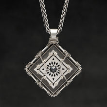 Load image into Gallery viewer, Hanging front view of Sterling Silver and 18K Palladium White Gold Accents and Black Sapphire Sewn Silver Metal Confidence pendant and chain with endless loop necklace featuring 4 pointed gear by Caps Brothers