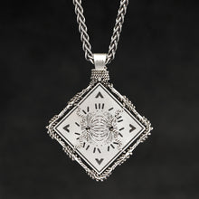 Load image into Gallery viewer, Hanging reverse view of Sterling Silver and 18K Palladium White Gold Accents Sewn Silver Metal Confidence pendant and chain with endless loop necklace featuring Electromagnetic Field and Cardinal Directions by Caps Brothers
