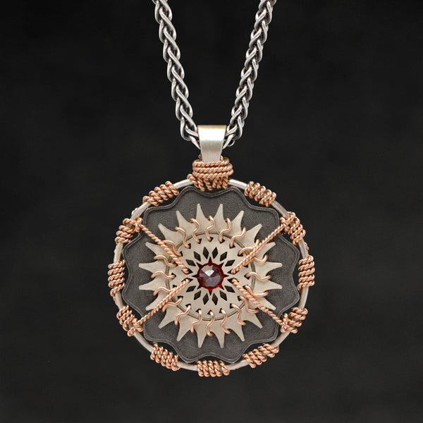Hanging front view of 18K Rose Gold and 18K Palladium White Gold and Sterling Silver and Ruby Sewn Gold Metal Majesty pendant and chain with endless loop necklace featuring 20 pointed gear by Caps Brothers