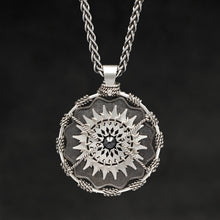 Load image into Gallery viewer, Hanging front view of Sterling Silver and 18K Palladium White Gold Accents and Black Sapphire Sewn Silver Metal Majesty pendant and chain with endless loop necklace featuring 20 pointed gear by Caps Brothers