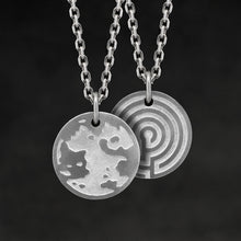 Load image into Gallery viewer, Hanging view of Platinum 950 Journey pendant and chain with endless loop necklace featuring the Map of Humanity as outward journey and labyrinth as inward journey by Caps Brothers