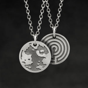 Hanging view of Sterling Silver Journey pendant and chain with endless loop necklace featuring the Map of Humanity as outward journey and labyrinth as inward journey by Caps Brothers