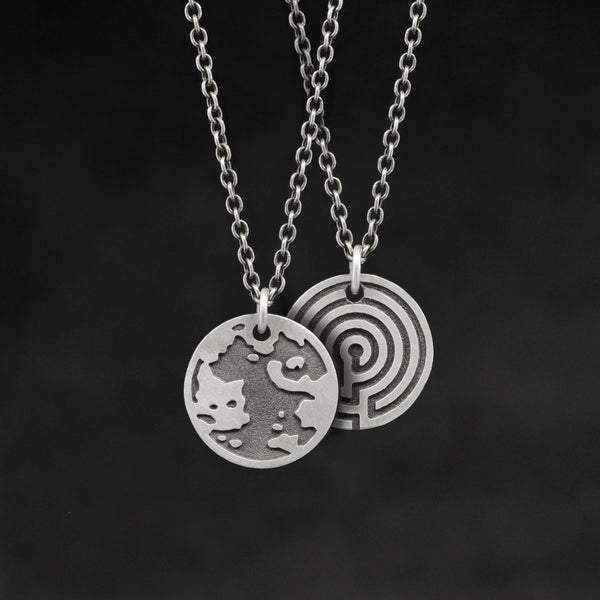 Hanging view of Sterling Silver Journey pendant and chain necklace featuring the Map of Humanity as outward journey and labyrinth as inward journey by Caps Brothers