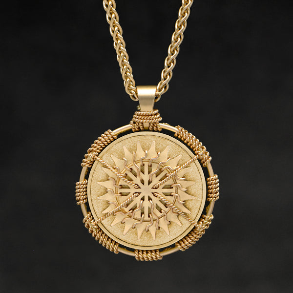 Hanging front view of 18K Yellow Gold Sewn Gold Metal Sun pendant and chain with endless loop necklace featuring 20 pointed gear by Caps Brothers