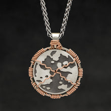 Load image into Gallery viewer, Hanging reverse view of 18K Rose Gold and 18K Palladium White Gold and Sterling Silver Sewn Silver Metal Sun pendant and chain with endless loop necklace featuring Map of Humanity by Caps Brothers
