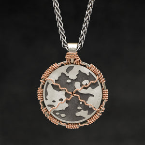 Hanging reverse view of 18K Rose Gold and 18K Palladium White Gold and Sterling Silver Sewn Silver Metal Sun pendant and chain with endless loop necklace featuring Map of Humanity by Caps Brothers