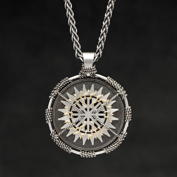 Hanging front view of Sterling Silver and 18K Yellow Gold Accents Sewn Silver Metal Sun pendant and chain with endless loop necklace featuring 20 pointed gear by Caps Brothers