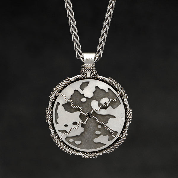Hanging reverse view of Sterling Silver and 18K Yellow Gold Accents Sewn Silver Metal Sun pendant and chain with endless loop necklace featuring Map of Humanity by Caps Brothers