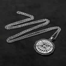 Load image into Gallery viewer, Laying down view of Platinum 950 Sewn Platinum Metal Compass pendant and chain with endless loop necklace featuring 20 pointed gear by Caps Brothers
