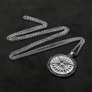 Laying down view of Platinum 950 Sewn Platinum Metal Compass pendant and chain with endless loop necklace featuring 20 pointed gear by Caps Brothers
