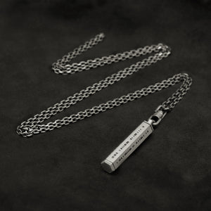 Laying down Code of Integrity hexagonal sterling silver pendant and chain with endless loop necklace featuring Truncated Barcode by Caps Brothers