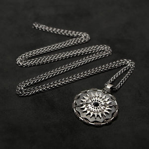 Laying down view of Sterling Silver and 18K Palladium White Gold Accents and Black Sapphire Sewn Silver Metal Majesty pendant and chain with endless loop necklace featuring 20 pointed gear by Caps Brothers