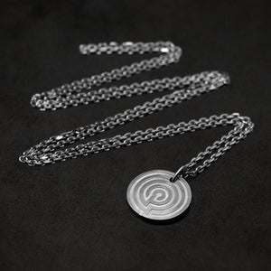 Laying down Platinum 950 Journey pendant and chain with endless loop necklace featuring labyrinth as inward journey by Caps Brothers