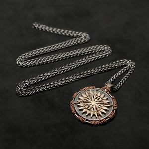 Laying down view of 18K Rose Gold and 18K Palladium White Gold and Sterling Silver Sewn Silver Metal Sun pendant and chain with endless loop necklace featuring 20 pointed gear by Caps Brothers