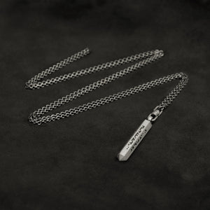Laying down Code of Wisdom hexagonal sterling silver pendant and chain with endless loop necklace featuring Binary Code by Caps Brothers