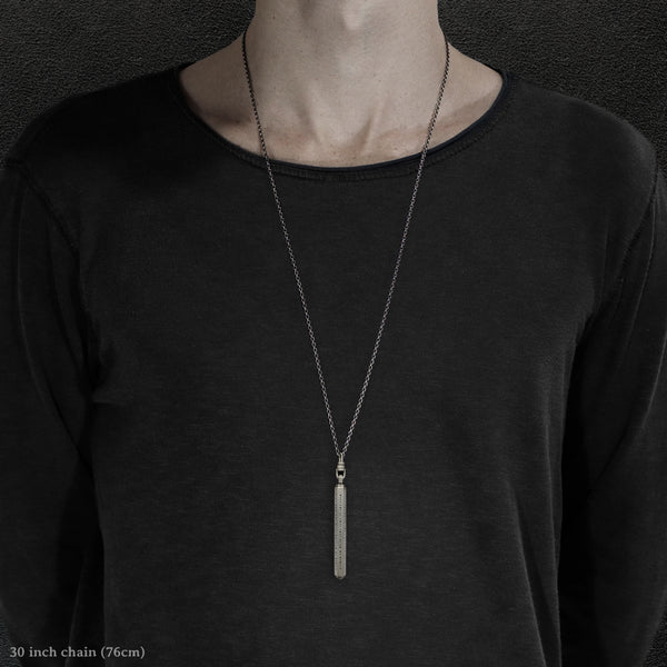 Model wearing Code of Consciousness hexagonal sterling silver pendant and chain with endless loop necklace featuring Dashless Morse Code by Caps Brothers