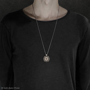 Model wearing 18K Palladium White Gold and Sterling Silver Sewn Gold Metal Compass pendant and chain with endless loop necklace featuring 20 pointed gear by Caps Brothers