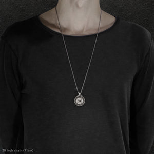 Model wearing Sterling Silver and 18K Palladium White Gold Accents Sewn Silver Metal Compass pendant and chain with endless loop necklace featuring 20 pointed gear by Caps Brothers