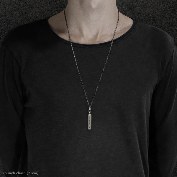 Model wearing Code of Gratitude hexagonal sterling silver pendant and chain with endless loop necklace featuring ASCII Rays Code by Caps Brothers