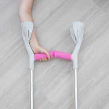 Load image into Gallery viewer, Hand on crutches with pink sleeve