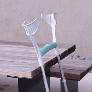 crutches leaning against bench