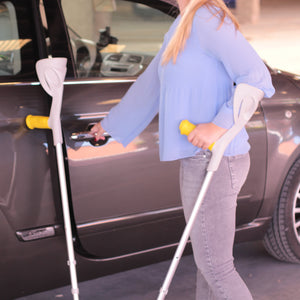 Opening car door with crutches
